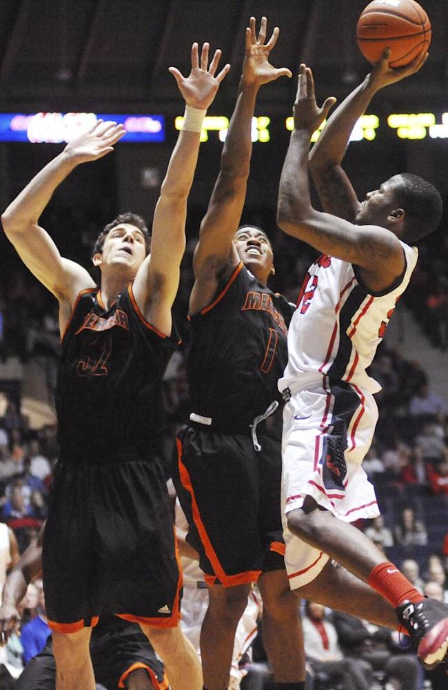 Mississippi's Jarvis Summers (32) scores over Mercer's Daniel Coursey (52) and Phillip Leonard (1) during an NCAA college basketball game in Oxford, Miss., on Sunday, Dec. 22, 2013. Mercer won 79-76