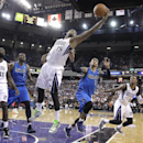 Sacramento Kings center DeMarcus Cousins, center, reaches out for a rebound against Dallas Mavericks guard Monta Ellis, second from right, during the fourth quarter of an NBA basketball game, Sunday, April 6, 2014, in Sacramento, Calif. The Mavericks won