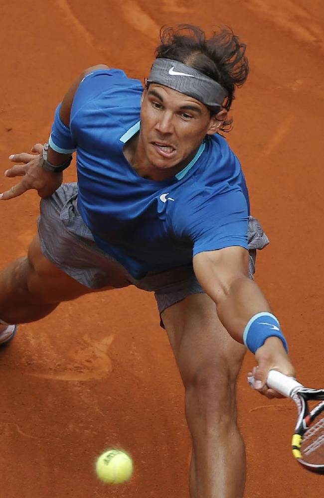 Rafael Nadal from Spain returns the ball during a Madrid Open tennis tournament match against Juan Monaco from Argentina, in Madrid, Spain, Wednesday, May 7, 2014