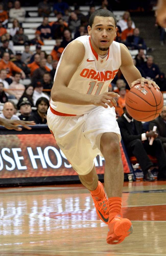 Syracuse's Tyler Ennis looks for an open man against Ryerson during the second half of a men's NCAA exhibition basketball game in Syracuse, N.Y., Tuesday, Nov. 5, 2013. Syracuse won 81-46