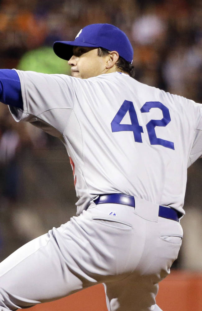 Los Angeles Dodgers starting pitcher Josh Beckett throws to the San Francisco Giants during the fourth inning of a baseball game on Tuesday, April 15, 2014, in San Francisco