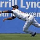 Minnesota Twins center fielder Aaron Hicks dives to grab a fly out by New York Yankees Kelly Johnson to end the fifth inning of an exhibition baseball game in Fort Myers, Fla., Saturday, March 22, 2014 The Associated Press