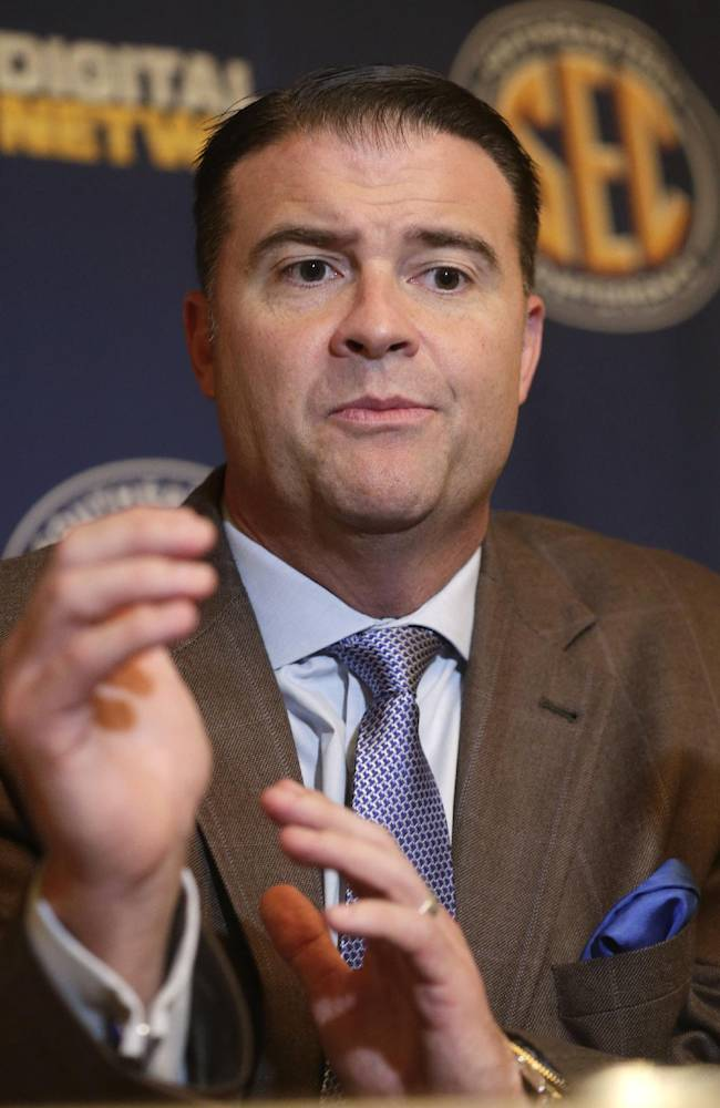 Kentucky women's coach Matthew Mitchell talks with reporters during the Southeastern Conference NCAA college basketball media day in Birmingham, Ala., Wednesday, Oct. 16, 2013