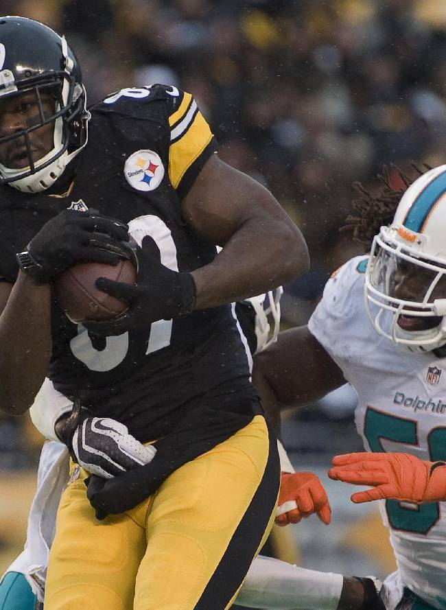 Pittsburgh Steelers wide receiver Jerricho Cotchery (89) makes a catch for a touchdown against Miami Dolphins middle linebacker Dannell Ellerbe (59) during the fourth quarter of an NFL football game on Sunday, Dec. 8, 2013, in Pittsburgh. Miami won 34-28