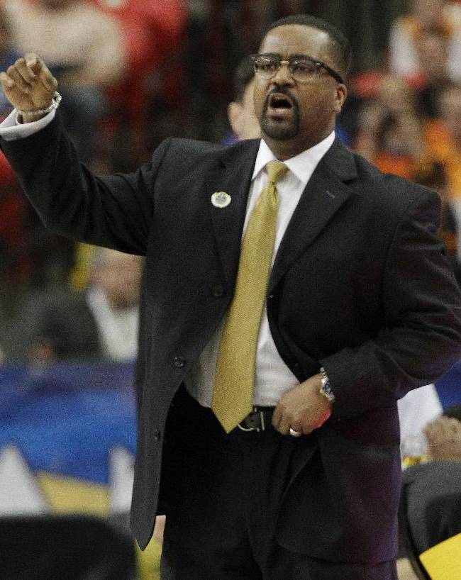 Missouri head coach Frank Haith speaks to his players against Florida during the first half of an NCAA college basketball game in the quarterfinal round of the Southeastern Conference men's tournament, Friday, March 14, 2014, in Atlanta