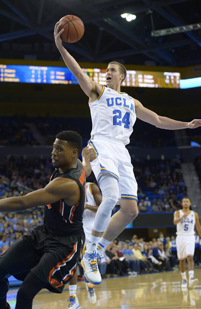 UCLA forward Travis Wear shoots as Oregon State guard Langston Morris-Walker defends during the second half of an NCAA college basketball game, Sunday, March 2, 2014, in Los Angeles. UCLA won 74-69