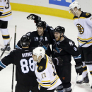San Jose Sharks center Joe Pavelski (8) celebrates his goal with teammates Joe Thornton (19) and Brent Burns (88) during the third period of an NHL hockey game against the Boston Bruins Thursday, Dec. 4, 2014, in San Jose, Calif. San Jose won 7-4 The Asso