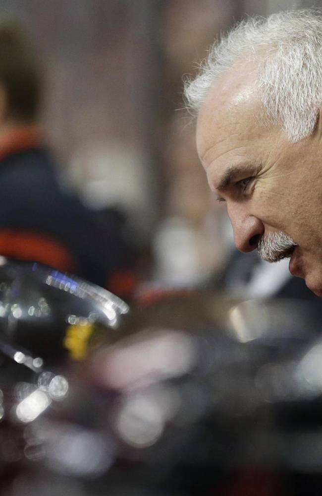 Chicago Blackhawks head coach Joel Quenneville talks to his team during the second period of an NHL preseason hockey game against the Washington Capitals in Chicago, Saturday, Sept. 28, 2013