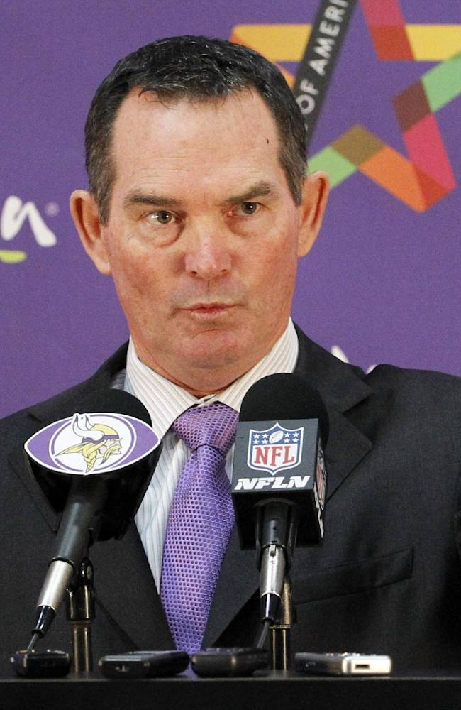 New Minnesota Vikings head coach Mike Zimmer answers a question during an NFL football media availability at Winter Park in Eden Prairie, Minn., Friday, Jan. 17, 2014