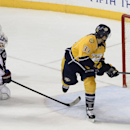 Nashville Predators center Colin Wilson (33) scores the go-ahead goal past Columbus Blue Jackets center Ryan Johansen (19) goalie Curtis McElhinney, behind, in the third period of an NHL hockey game Saturday, Nov. 29, 2014, in Nashville, Tenn. The Predato