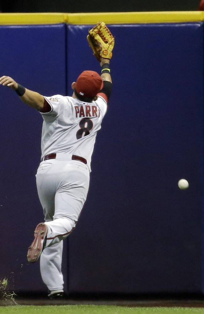 Arizona Diamondbacks' Gerardo Parra can't catch a double hit by Milwaukee Brewers' Logan Schafer during the first inning of a baseball game Tuesday, May 6, 2014, in Milwaukee