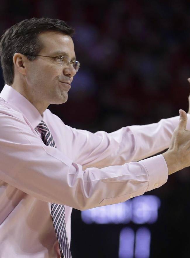 Nebraska coach Tim Miles gestures on the sidelines in the first half of an NCAA college basketball game against Penn State in Lincoln, Neb., Thursday, Feb. 20, 2014