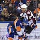 New York Islanders defenseman Nick Leddy (2) tangles with Colorado Avalanche right wing Jarome Iginla (12) against the boards in the third period of an NHL hockey game at Nassau Coliseum on Tuesday, Nov. 11, 2014, in Uniondale, N.Y. Leddy scored during th