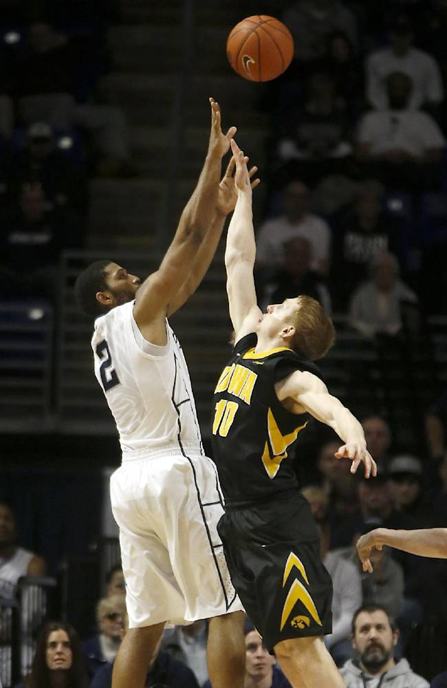 Penn State's D.J. Newbill (2) shoots over Iowa's Mike Gesell (10) during the second half of an NCAA college basketball game on Saturday, Feb. 15, 2014, in State College. Iowa won 82-70