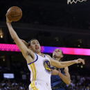 Golden State Warriors' Klay Thompson goes up for a dunk next to Minnesota Timberwolves' Kevin Martin during the second half of an NBA basketball game on Monday, April 14, 2014, in Oakland, Calif. Golden State won 130-120 The Associated Press