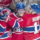 Montreal Canadiens' Lars Eller, centre, celebrates with teammates Brian Gionta, left, and Rene Bourque after scoring against the Tampa Bay Lightning during first period NHL Stanley Cup playoff action in Montreal, Tuesday, April 22, 2014 The Associated Pre