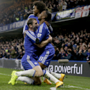 Chelsea's Didier Drogba, right, celebrates scoring his side's second goal with Branislav Ivanovic, left, and Willian during the English Premier League soccer match between Chelsea and Tottenham Hotspur at Stamford Bridge stadium in London, Wednesday, Dec.