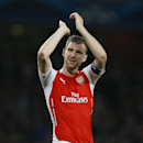 Arsenal's Per Mertesacker applauds the fans at the end of their second leg Champions League qualifying soccer match between Arsenal and Besiktas at Emirates Stadium in London Wednesday, Aug. 27, 2014. Arsenal won the game 1-0. (AP Photo/Kirsty Wiggleswort