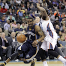 The Memphis Grizzlies' Mike Conley (11) gets around by Charlotte Bobcats' Kemba Walker (15) during the second half of an NBA basketball game in Charlotte, N.C., Saturday, Feb. 22, 2014. The Bobcats won 92-89. (AP Photo/Bob Leverone)