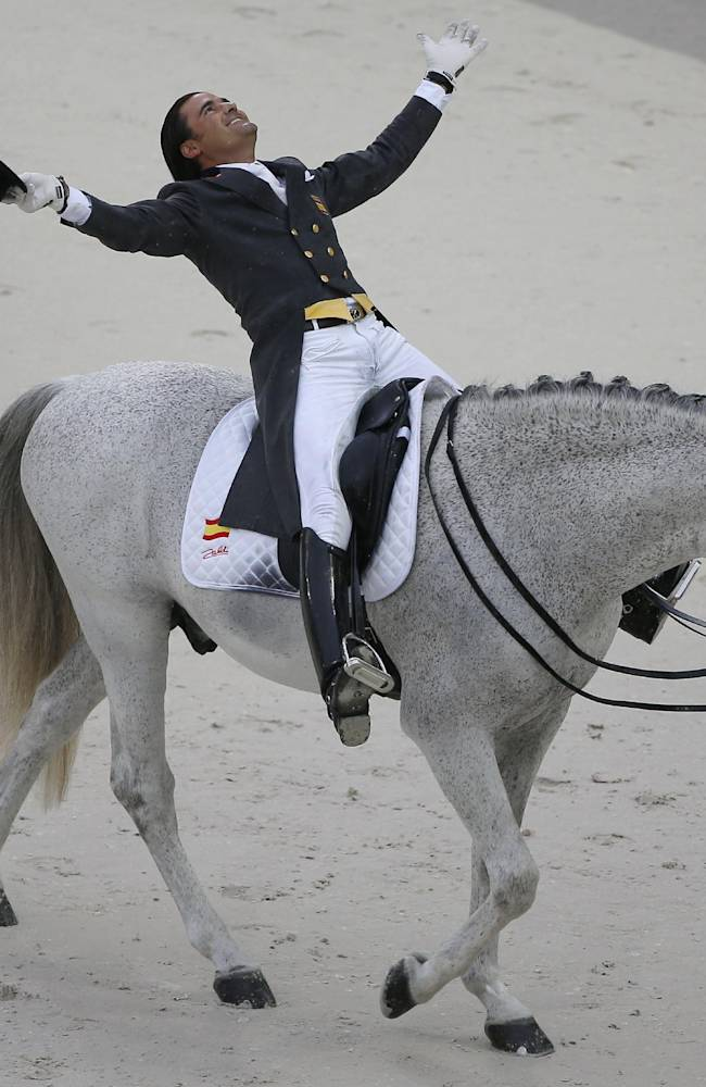 Jose Antonio Garcia Mena of Spain, riding Norte Lovera, acknowledges applauses after the presentation during the first day of Dressage team competition at the FEI World Equestrian Games, at Michel d'Ornano stadium in Cean, western France, Monday, Aug. 25, 2014