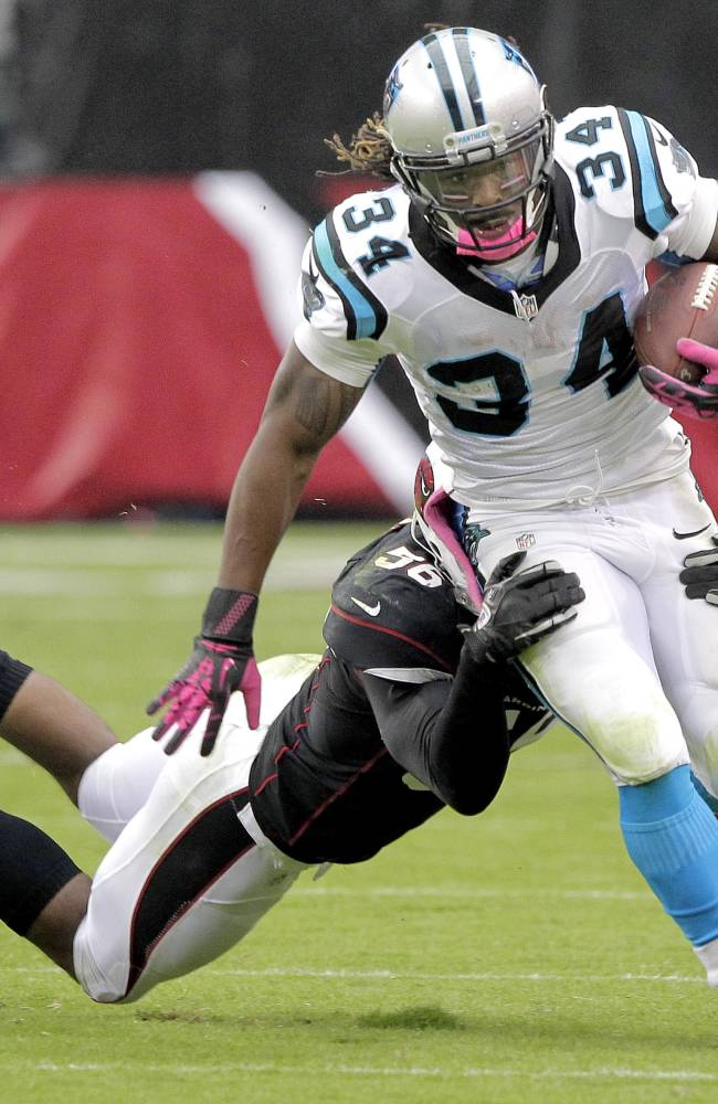 Carolina Panthers running back DeAngelo Williams (34) is tackled by Arizona Cardinals inside linebacker Karlos Dansby (56) during the second half of a NFL football game, Sunday, Oct. 6, 2013, in Glendale, Ariz