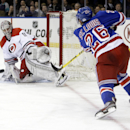 Carolina Hurricanes goalie Cam Ward (30) stops a shot by New York Rangers' Martin St. Louis (26) during the second period of an NHL hockey game Tuesday, April 8, 2014, in New York The Associated Press
