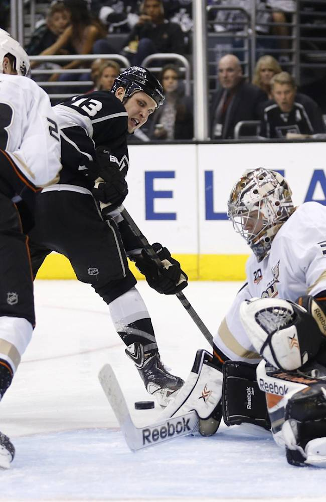 Anaheim Ducks goalie Frederik Andersen prevents Los Angeles Kings left wing Kyle Clifford, center, from scoring as Ducks' Mark Fistric, left, also defends during the second period of an NHL hockey game in Los Angeles, Saturday, March 15, 2014. The Ducks won 2-1