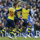 Arsenal's Theo Walcott, right, celebrates after scoring a goal during the English FA Cup 4th round soccer match between Brighton & Hove Albion and Arsenal at the Amex Stadium, Brighton, England, Sunday, Jan. 25, 2015