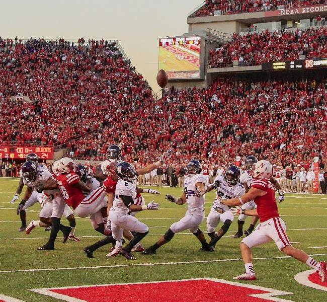 In this image from Nov. 2, 2013, a scrum of Nebraska and Northwestern players follow a tipped ball after Nebraska wide receiver Quincy Enunwa (18), Northwestern center back Dwight White (2), safety Traveon Henry (10), and safety Ibraheim Campbell (24), vied for a ball thrown by Nebraska quarterback Ron Kellogg III (12) with no time on the clock, in an NCAA college football game in Lincoln, Neb.The ball was subsequently caught by Nebraska wide receiver Jordan Westerkamp, right, for a touchdown, giving Nebraska a 27-24 win. If Nebraska makes it back to the Big Ten championship game, the Cornhuskers might look at Westerkamp's tipped-ball touchdown on the last play against Northwestern as the one that saved their season and maybe even Bo Pelini's job