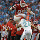 In this Sept. 21, 2014, file photo, Kansas City Chiefs tight end Travis Kelce (87) jumps to avoid a tackle by Miami Dolphins cornerback Cortland Finnegan (24) during the second half of an NFL football game in Miami Gardens, Fla. In the words of Chiefs coa