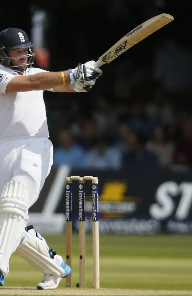 England's Matt Prior hits two runs off the bowling of Sri Lanka's Nuwan Pradeep on the second day of the first test cricket match between England and Sri Lanka at Lord's cricket ground in London, Friday June 13, 2014