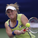 Melanie Oudin, of the United States, hits the ball during her match against Angelique Kerber, from Germany, at the Citi Open tennis tournament in Washington, Thursday, Aug. 1, 2013. (AP Photo/Pablo Martinez Monsivais)