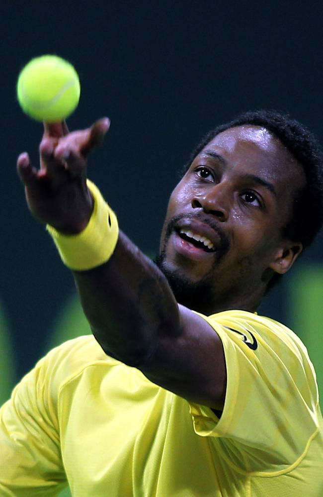 France's Gael Monfils serves to Germany's Florian Meyer in their semifinal match during the Qatar Open tennis tournament at the Khalifa Tennis Complex in Doha, Qatar, Friday, Jan. 3, 2014