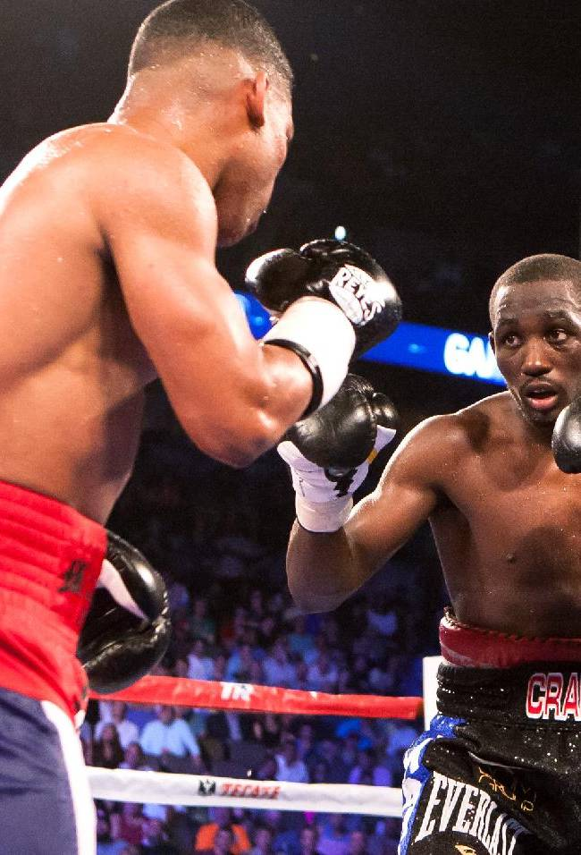 Terence Crawford, right, and Yuriorkis Gamboa face off during the WBO lightweight boxing bout Saturday, June 28, 2014, in Omaha, Neb. Crawford won the bout in the ninth round