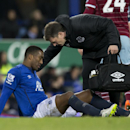Everton's Sylvain Distin, bottom, is treated on the pitch before being substituted injured during his team's English FA Cup third round soccer match against West Ham United at Goodison Park Stadium, Liverpool, England, Tuesday Jan. 6, 2015