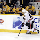 Chicago Blackhawks right wing Marian Hossa (81), of Slovakia, scores an empty net goal against the Nashville Predators in the third period of an NHL hockey game to give the Blackhawks a 3-1 win Saturday, Dec. 6, 2014, in Nashville, Tenn The Associated Pre