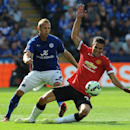 Leicester's Ritchie De Laet, left, tackles Manchester United's Robin van Persie during the English Premier League soccer match between Leicester City and Manchester United at King Power Stadium, in Leicester, England, Sunday, Sept. 21, 2014