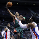 Milwaukee Bucks guard Ramon Sessions (13) goes to the basket against Detroit Pistons forward Greg Monroe, left, and center Andre Drummond, right, during the first half of an NBA basketball game Monday, March 31, 2014, in Auburn Hills, Mich The Associated