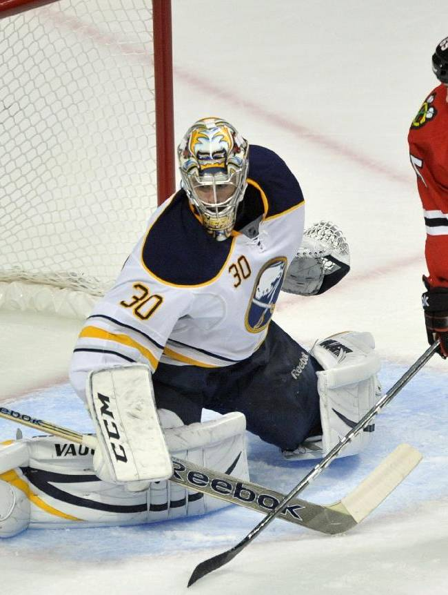 Buffalo Sabres goalie Ryan Miller makes a save against Chicago Blackhawks' Andrew Shaw during the first period of an NHL hockey game in Chicago, Saturday, Oct. 12, 2013