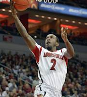 Louisville's Russ Smith goes in for a layup during the second half of an NCAA college basketball game against the College of Charleston, Saturday, Nov. 9, 2013, in Louisville, Ky. Louisville defeated the College of Charleston 70-48. (AP Photo/Timothy D. Easley)