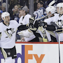 Pittsburgh Penguins' Craig Adams (27) celebrates his goal against the Winnipeg Jets during the second period of an NHL hockey game in Winnipeg, Manitoba, on Thursday, April 3, 2014 The Associated Press