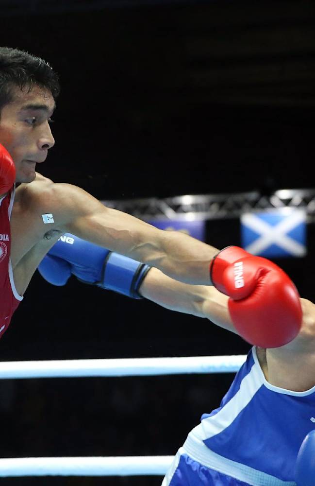 India's Shiva Thapa, left, fights Northern Ireland's Michael Conlan in the men's bantamweight in the preliminaries bout at the Commonwealth Games Glasgow 2014, Glasgow, Scotland, Monday July 28, 2014
