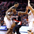 Portland Trail Blazers' Damian Lillard (0) loses the ball as Phoenix Suns' Channing Frye, left, and Goran Dragic, of Slovenia, right, defend during the first half of an NBA basketball game, Wednesday, Nov. 27, 2013, in Phoenix The Associated Press