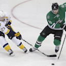 Nashville Predators right wing Patric Hornqvist (27) of Sweden and Dallas Stars center Tyler Seguin (91) skate for the puck during the first period of an NHL hockey game Tuesday, April 8, 2014, in Dallas The Associated Press