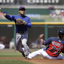 Cleveland Indians' Michael Brantley is forced at second as Texas Rangers' Kensuke Tanaka throws to first to complete a double play during second inning of a spring exhibition baseball game Tuesday, March 25, 2014, in Goodyear, Ariz The Associated Press