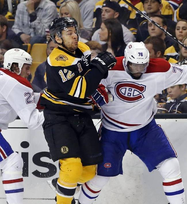 Boston Bruins right wing Jarome Iginla (12) grapples along the boards with Montreal Canadiens right wing Dale Weise (22) and defenseman P.K. Subban during the second period in Game 1 of an NHL hockey second-round playoff series in Boston, Thursday, May 1, 2014