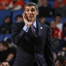Villanova head coach Jay Wright calls out to his team during the second half of a third-round game against Connecticut in the NCAA men's college basketball tournament in Buffalo, N.Y., Saturday, March 22, 2014. Connecticut won the game 77-65. (AP Photo/Bill Wippert)