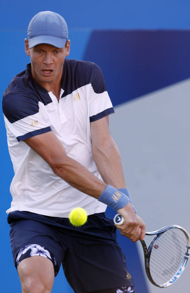 Czech Tomas Berdych in action against Australian James Duckworth at the Queen's Club grass-court tournament in  London Tuesday June 10, 2014. (AP Photo / Jonathan Brady, PA)