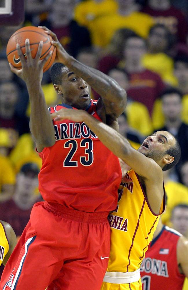 Arizona forward Rondae Hollis-Jefferson, left, grabs a rebound away from Southern California guard Julian Jacobs during the second half of an NCAA college basketball game, Sunday, Jan. 12, 2014, in Los Angeles