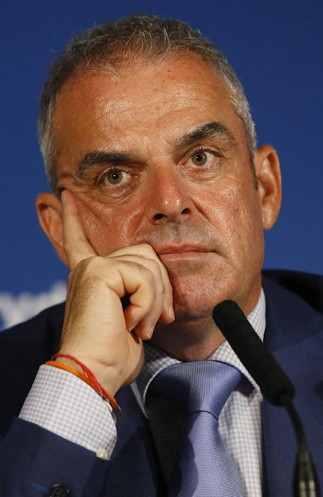 European Ryder cup team captain Paul McGinley listens during a press conference at Wentworth Golf Club to announce his three wild card selections for his team to play at Gleneagles in Scotland against the USA, in Wentworth England, Tuesday, Sept. 2, 2014